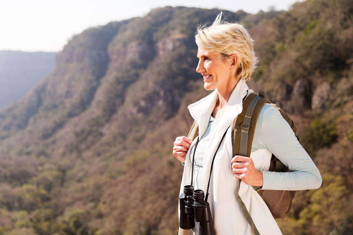 women hiking and smiling without fear bowel incontinence